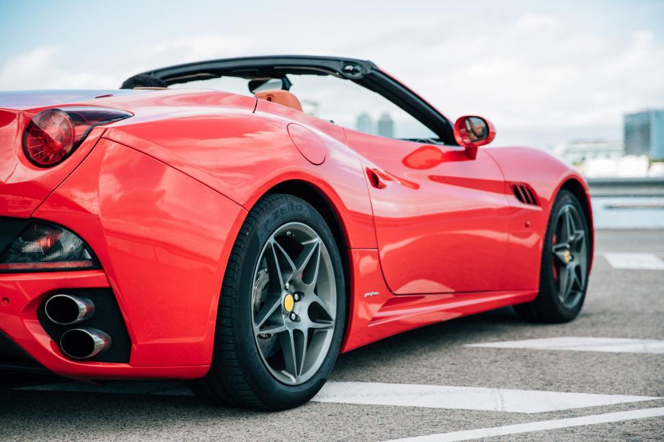 Download Free Stock Photo of Side view of a red convertible sports car