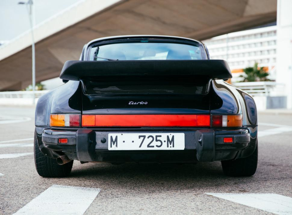 Download Free Stock HD Photo of Rear view of a black sports car Online