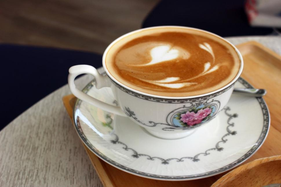 Download Free Stock HD Photo of Hot Latte Coffee with Heart Art in a Classical Porcelain Cup and Saucer  Online