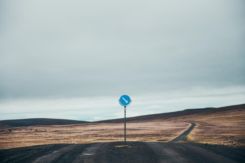 Download Free Stock HD Photo of Arrow road sign on a desert highway Online