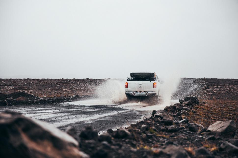 Download Free Stock Photo of Rear view of pick-up truck puddle splashing off-road