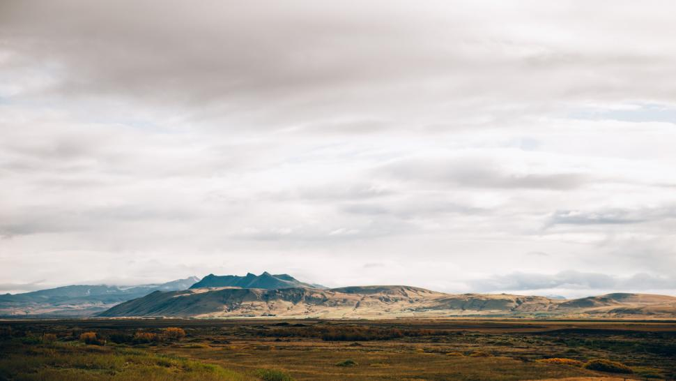Download Free Stock Photo of Panoramic view of gray cloudy sky over the vast field
