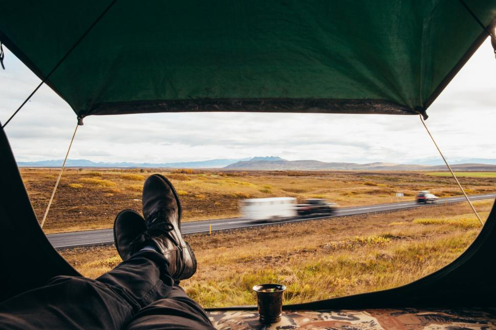 Download Free Stock Photo of A hiker s relaxed feet in roadside camping