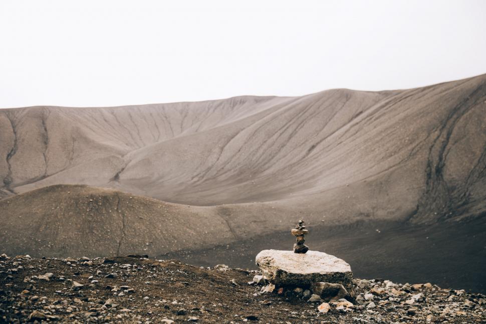 Download Free Stock HD Photo of Stacked stones rock art in the desert hills Online