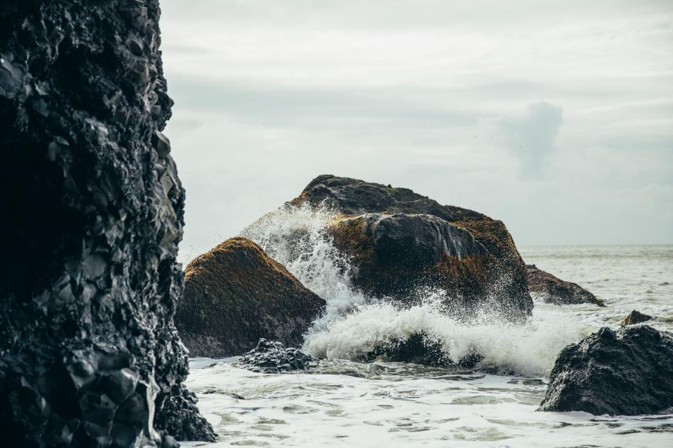 Download Free Stock Photo of Black volcanic rocks by the sea