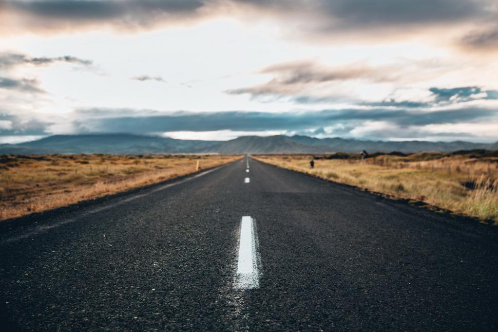 Download Free Stock Photo of An asphalt highway on a cloudy day
