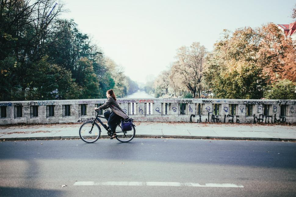 Download Free Stock HD Photo of Cyclist on a river bridge in a winter day Online