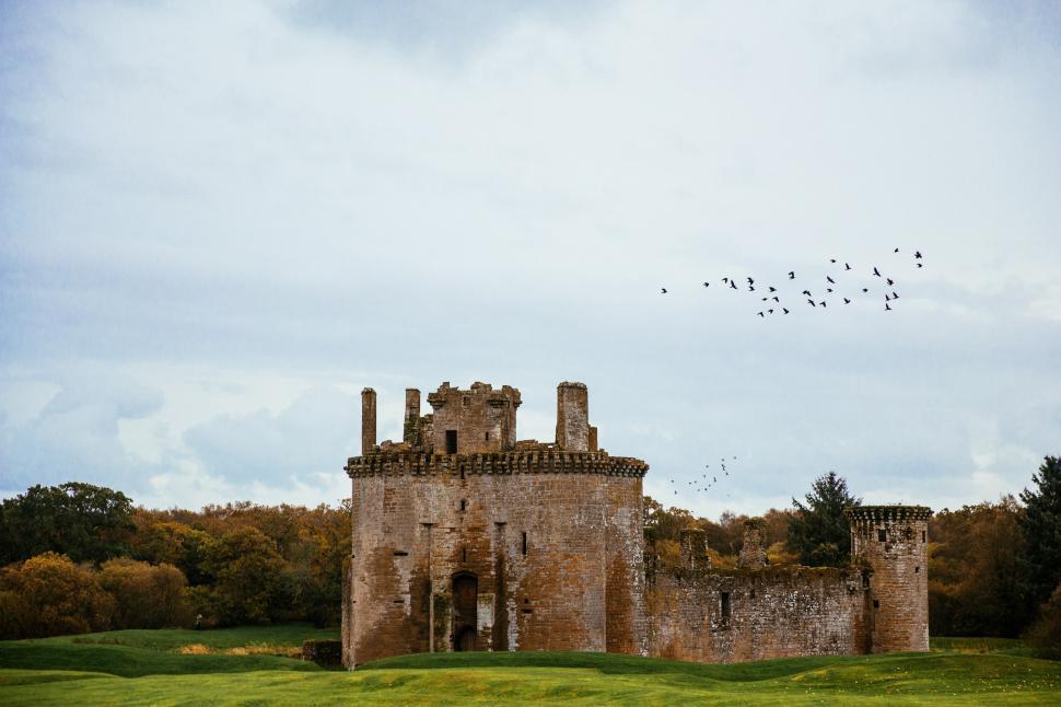 Download Free Stock Photo of Birds flying over Caerlaverock Castle