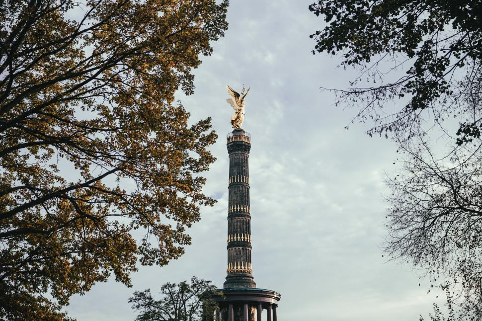 Download Free Stock HD Photo of Berlin Victory Column through trees Online