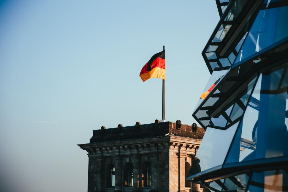 Download Free Stock Photo of German flag waves on a rooftop