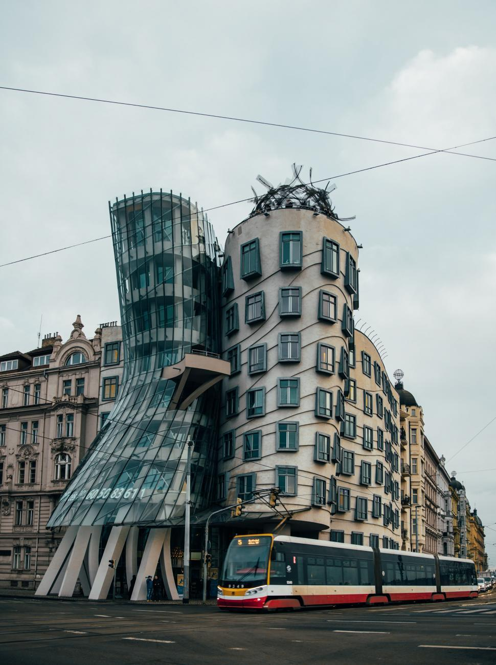 Download Free Stock HD Photo of Dancing House in Prague with Train Online