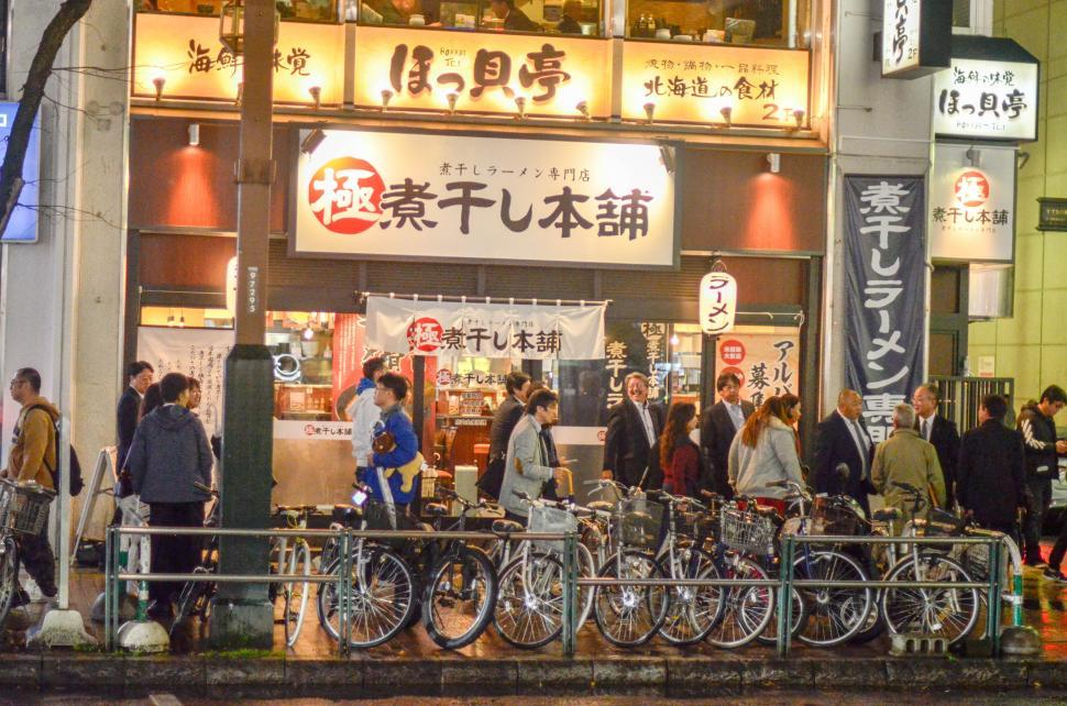 Download Free Stock Photo of Bicycles and Business at Night in Japan