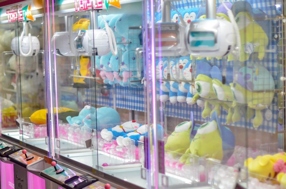Download Free Stock HD Photo of Catch a doll game with plush prizes Online