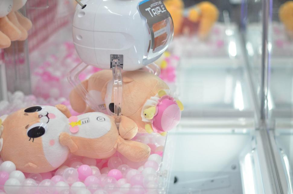 Download Free Stock HD Photo of Catch a doll crane game Online