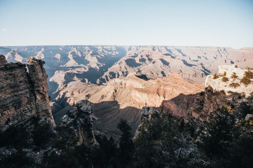 Download Free Stock HD Photo of Sun and shadows sprawling over grand canyons Online