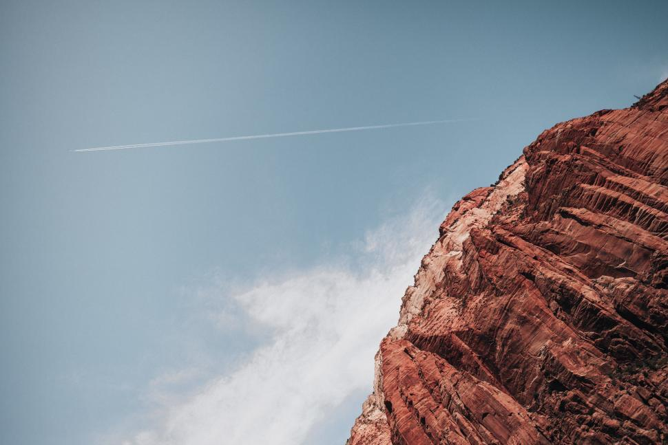 Download Free Stock HD Photo of Jetstream following an air plane over grand canyon Online