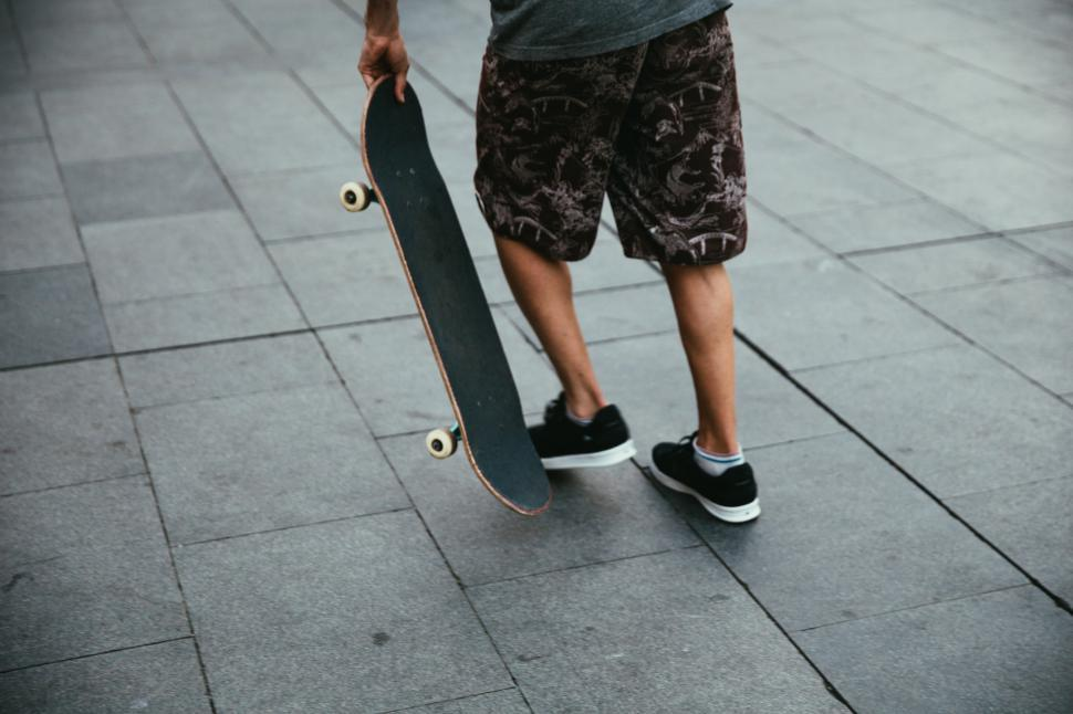 Download Free Stock HD Photo of Skateboarder getting ready to skate Online