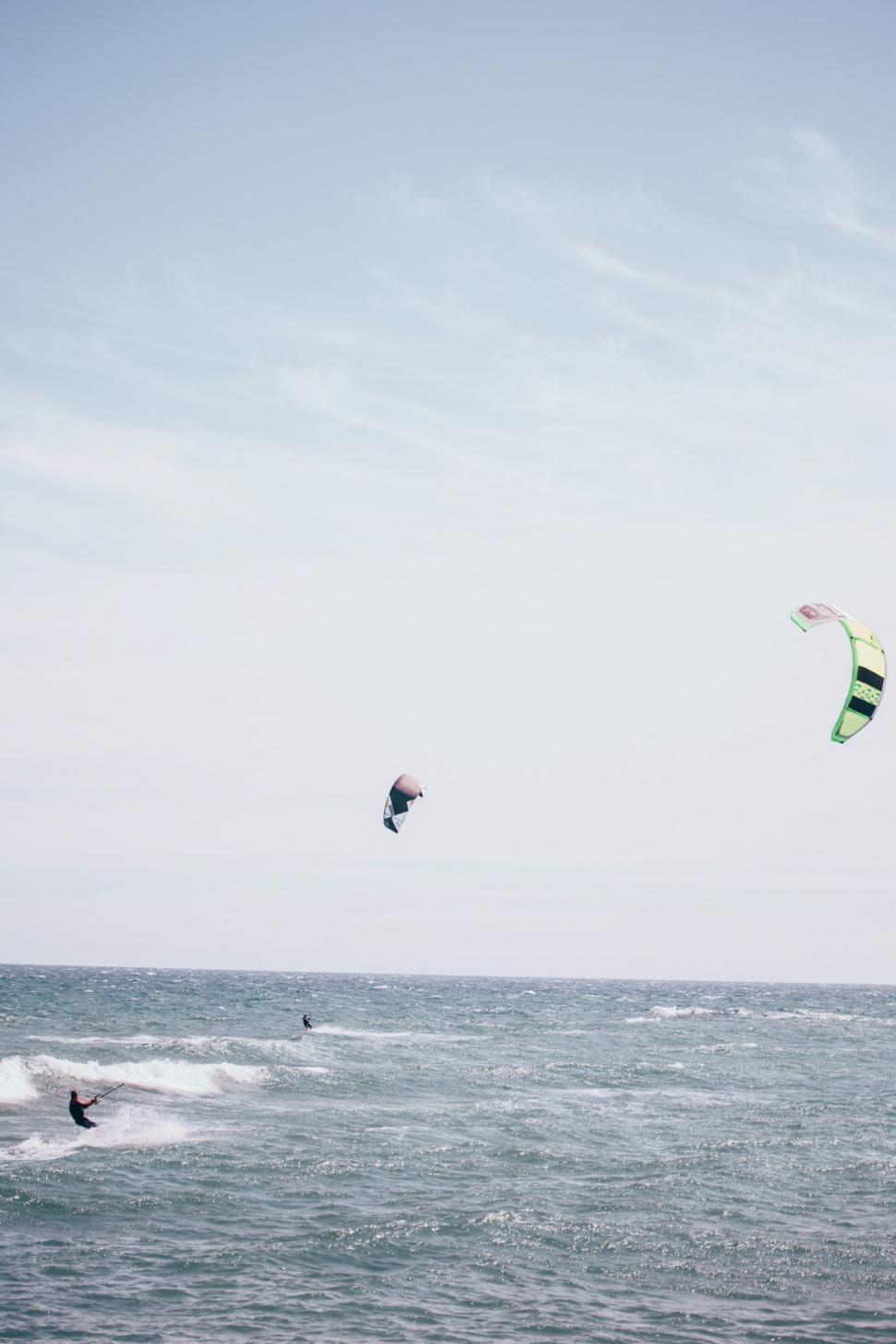 Download Free Stock Photo of Surfboarding with surfing kite