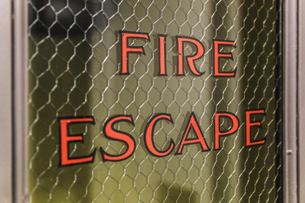 Download Free Stock HD Photo of Close up of Fire Escape written on a door Online