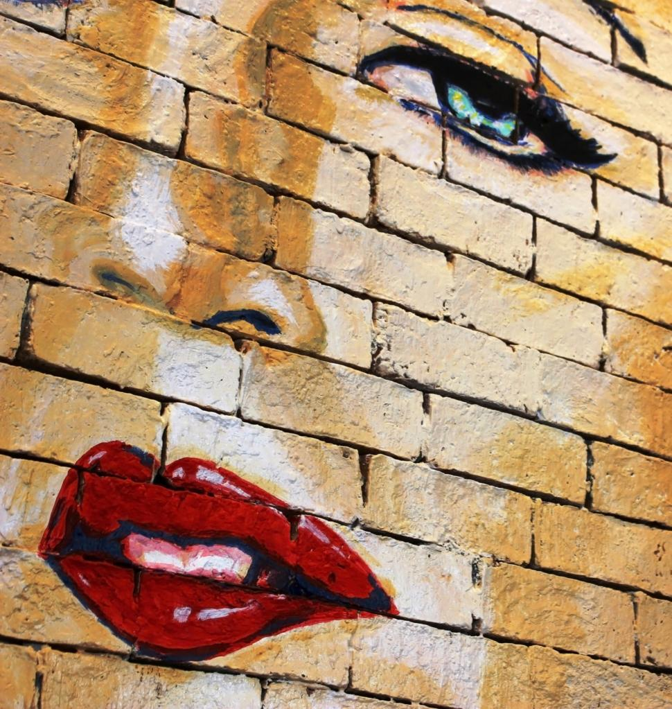 Download Free Stock Photo of Woman's face painted on a brick wall