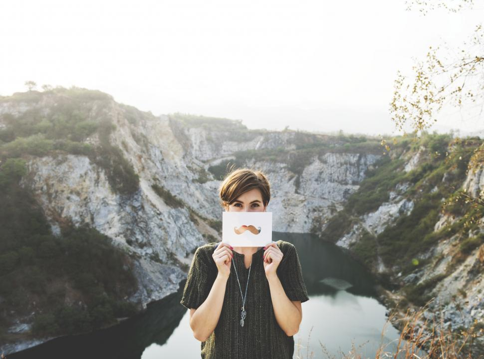 Download Free Stock Photo of A young caucasian woman posing with mustache shaped paper cutout