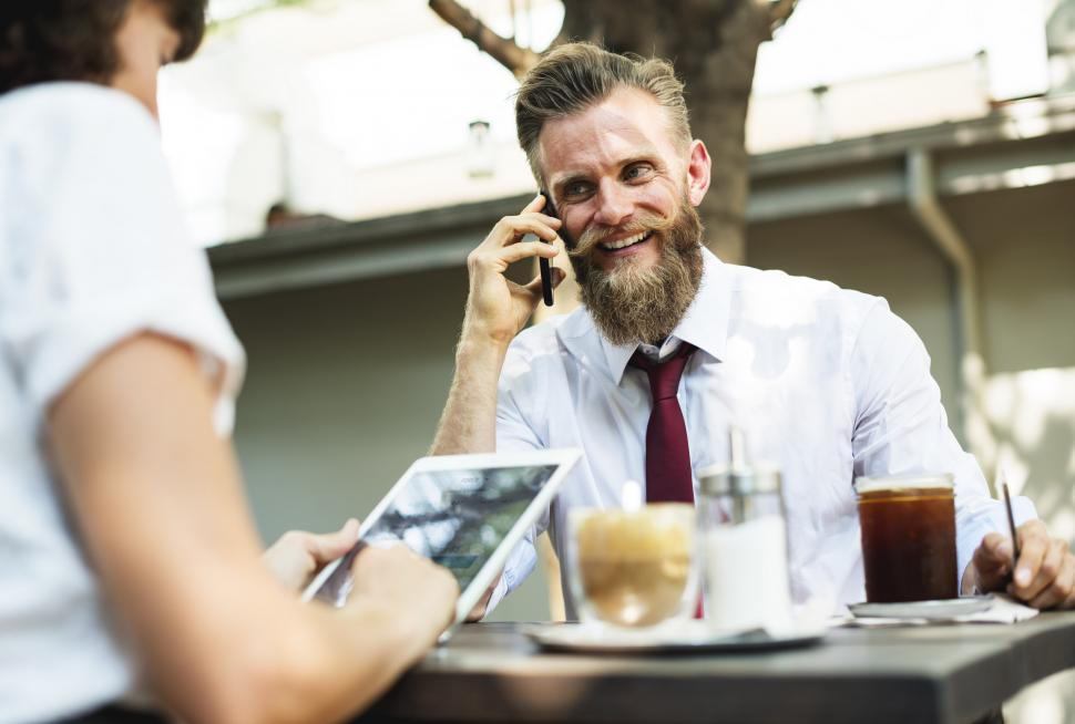 Download Free Stock Photo of Portrait of bearded man talking on the mobile phone at an outdoo