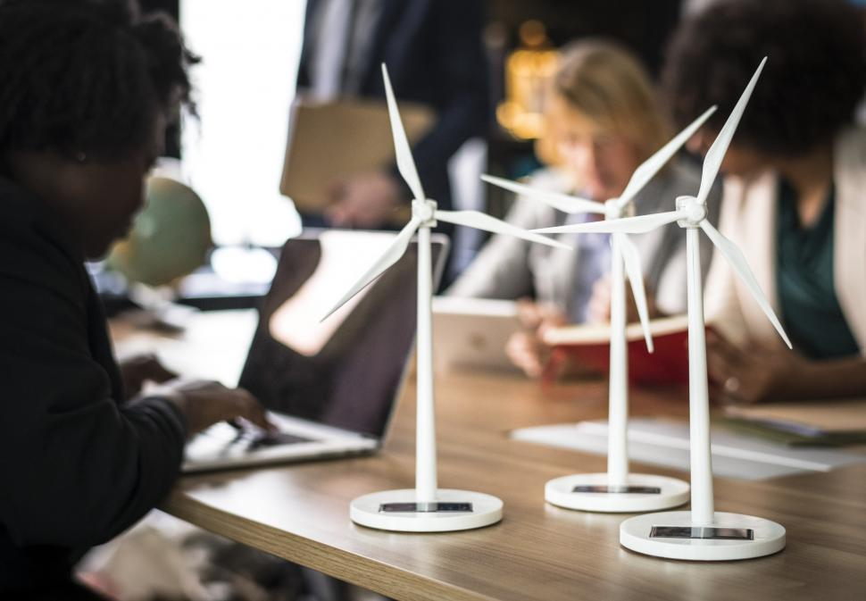 Download Free Stock HD Photo of Miniature models of wind turbines on the office table Online