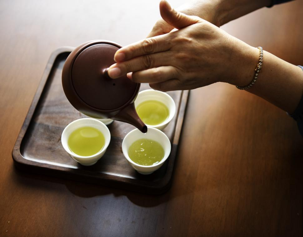 Download Free Stock HD Photo of Green tea being in traditional white cups Online