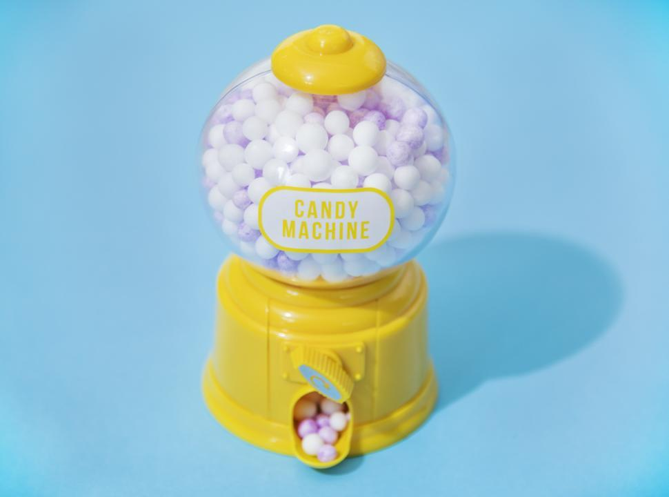 Download Free Stock Photo of A retro chewing gum machine filled with gumballs