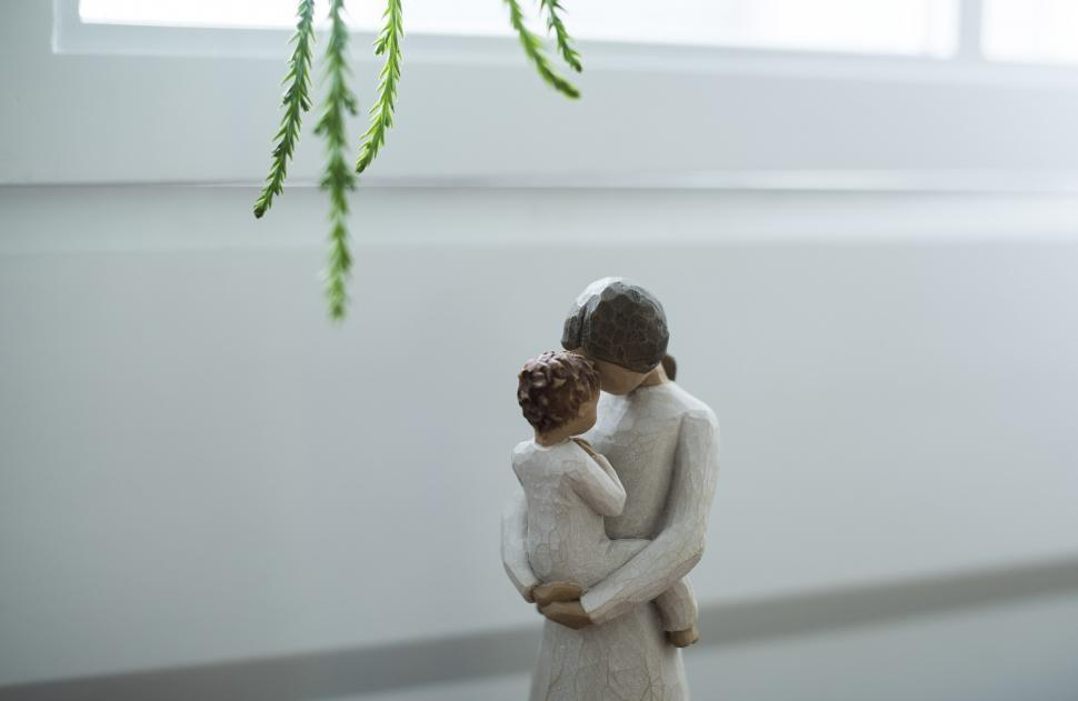 Download Free Stock Photo of A Stone sculpture of a mother holding a baby