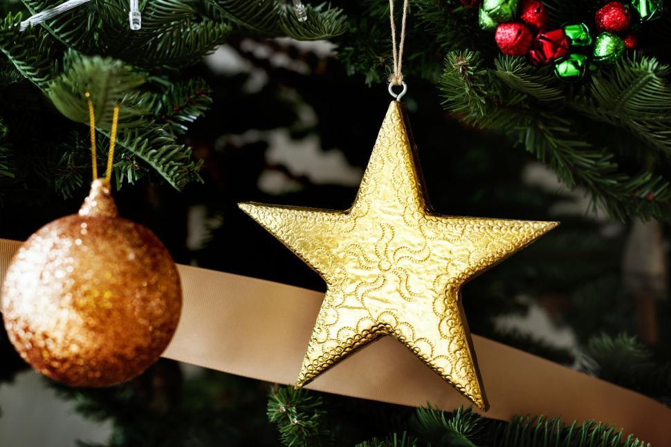 Download Free Stock HD Photo of A golden bauble and a star on the Christmas tree Online