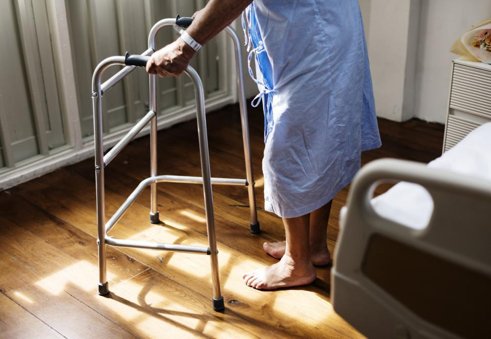 Download Free Stock Photo of A patient holding a walking frame