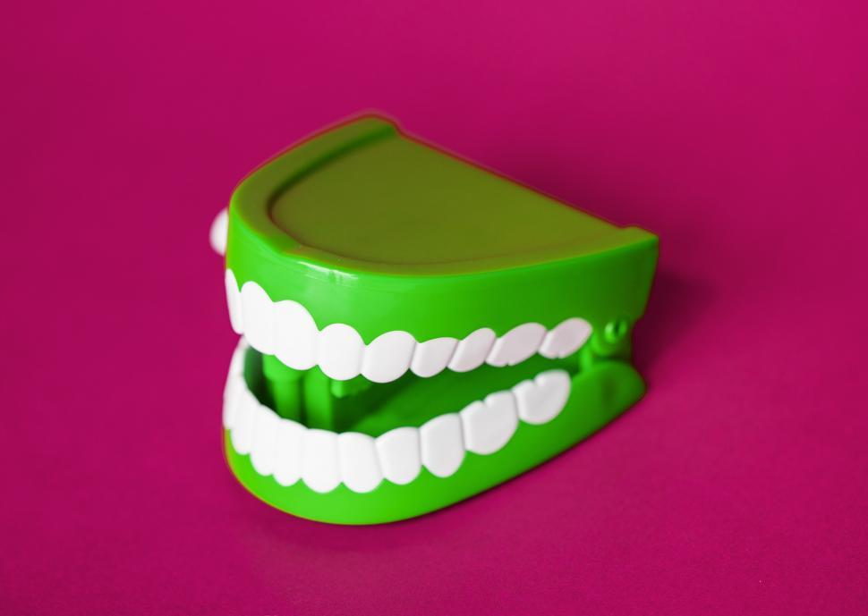 Download Free Stock HD Photo of A chattering teeth toy on magenta surface Online
