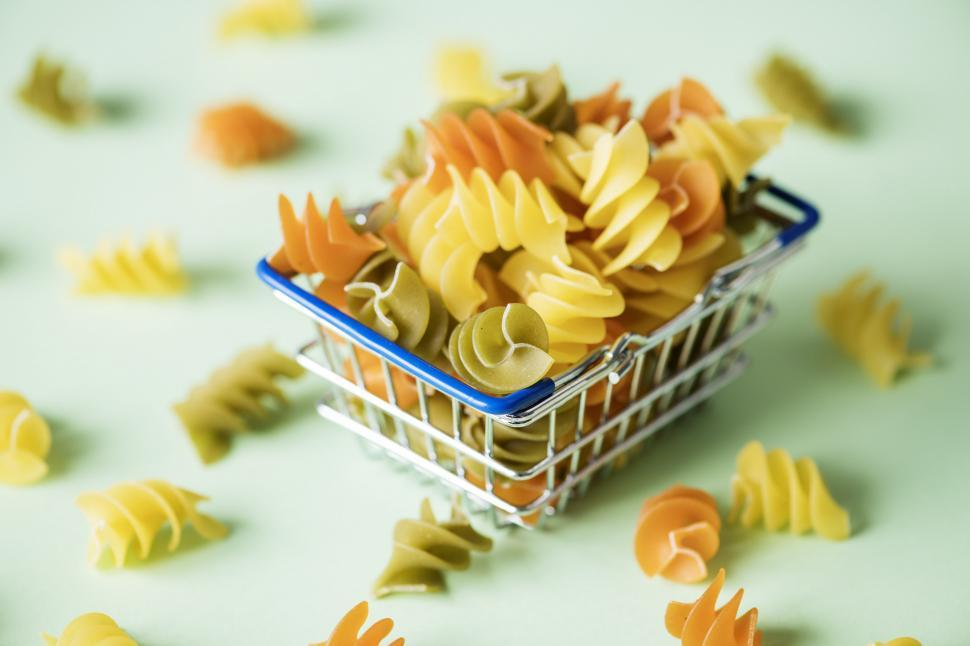 Download Free Stock Photo of Rotini Spirals pasta in a steel wire basket