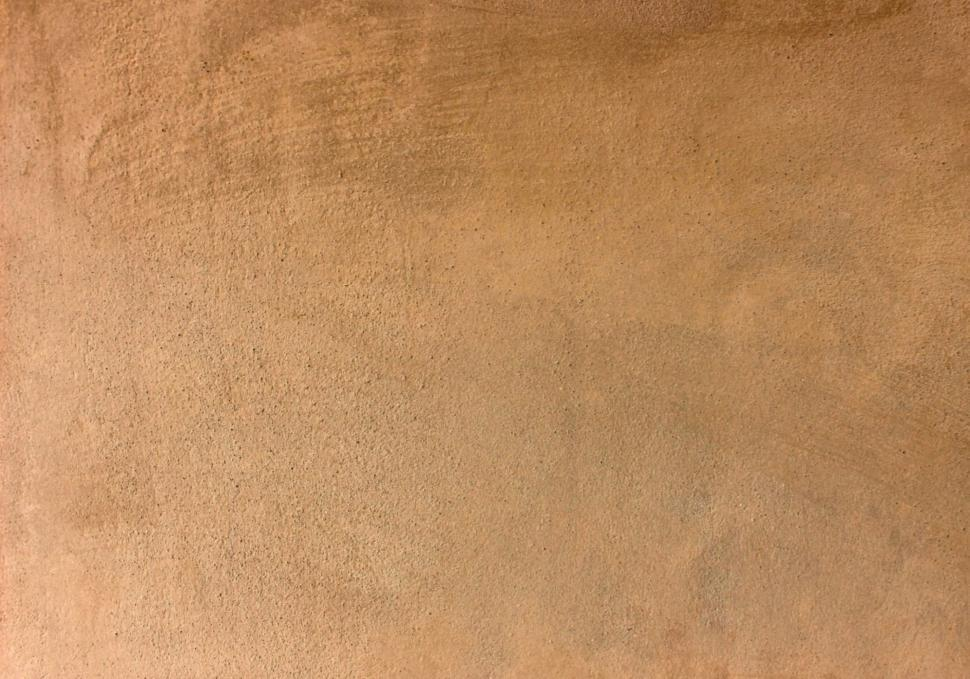Download Free Stock Photo of Dusty brown clay colored surface background