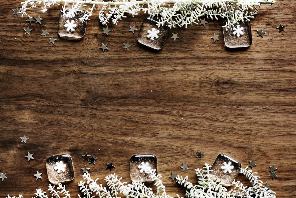 Download Free Stock HD Photo of Flat lay of Christmas decoration items on wooden tabletop Online