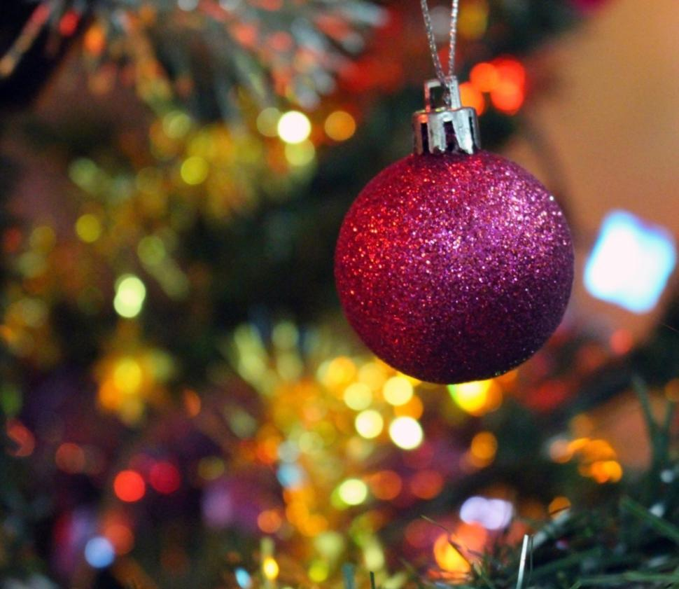 Download Free Stock Photo of Festive Background Baubles hanging on a Christmas tree