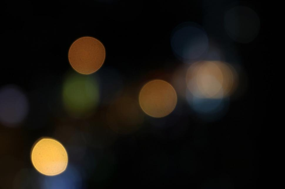 Download Free Stock Photo of Bokeh light effect with dark blank black space
