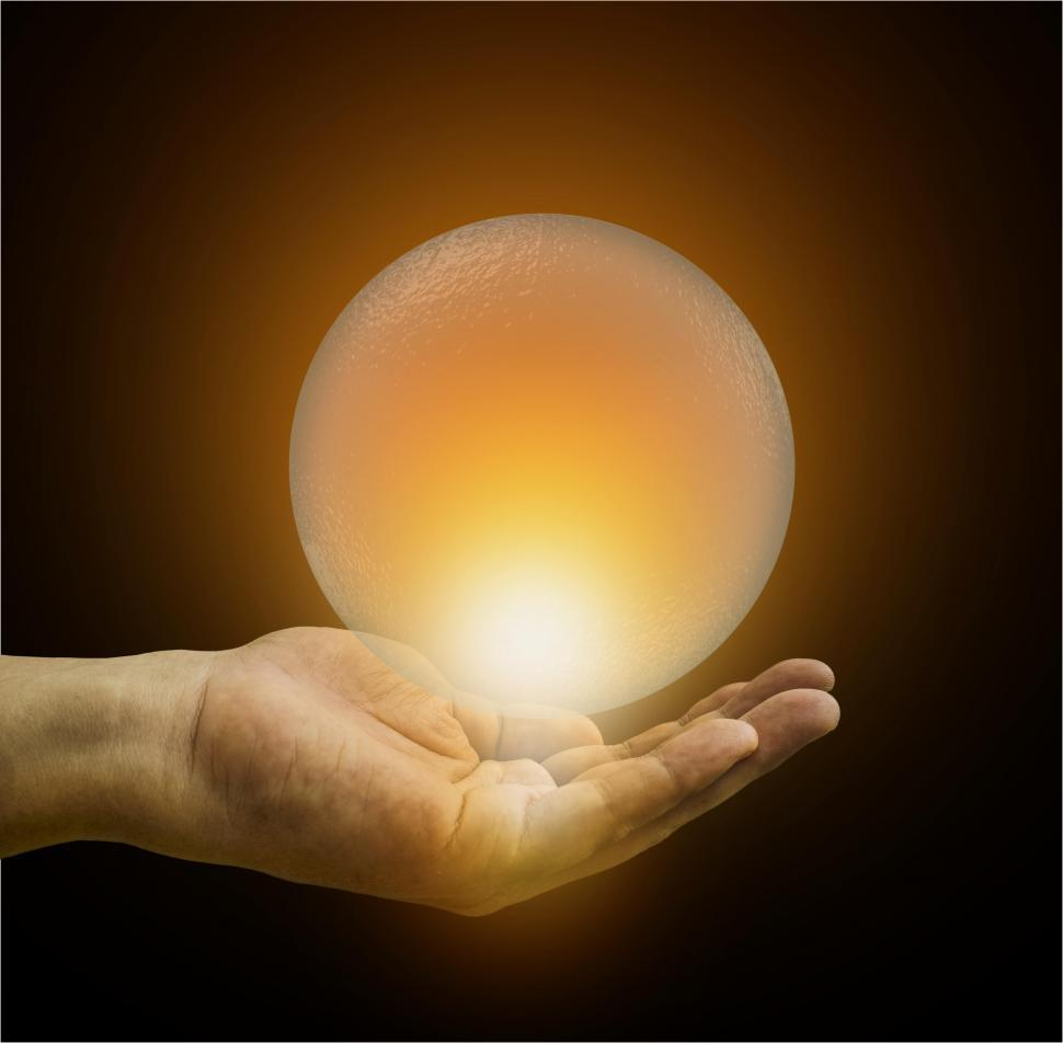 Download Free Stock Photo of Hand Holding Glowing Crystal Ball Closer - Predicting the Future Concept - Divination