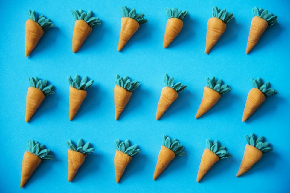 Download Free Stock HD Photo of Artificial clay carrots on blue background Online