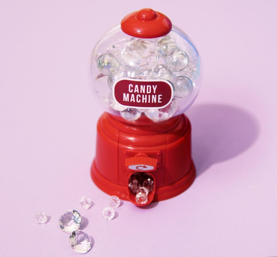 Download Free Stock Photo of A retro chewing gum machine filled with diamonds