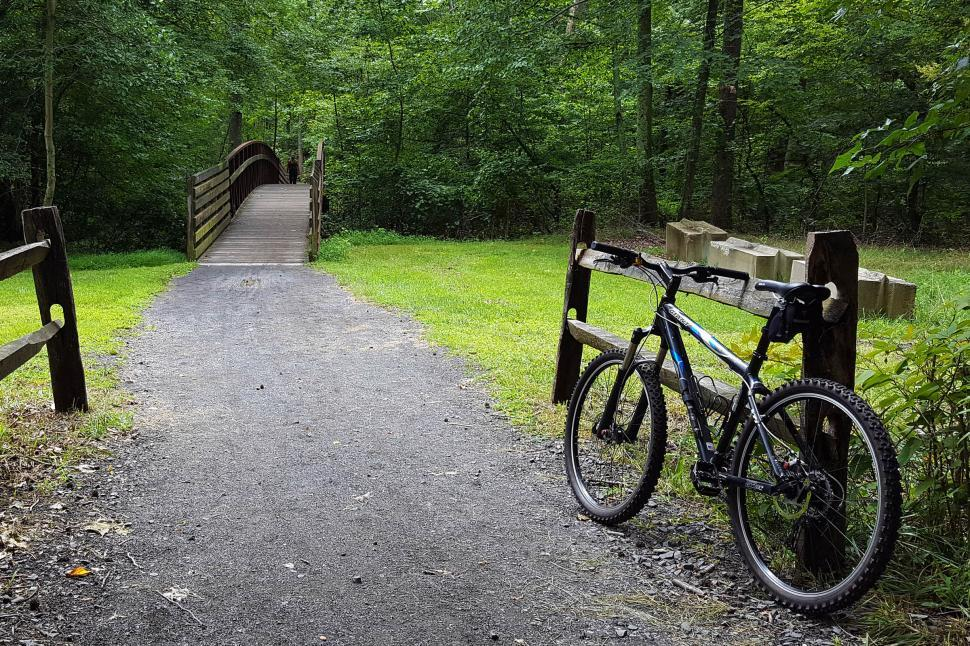 Download Free Stock HD Photo of Mountain Bikes By A Fence Online