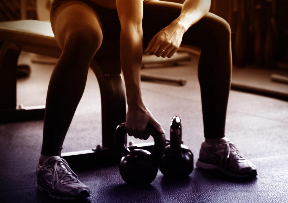 Download Free Stock HD Photo of Woman Lifting Kettlebells Online