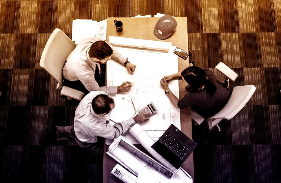 Download Free Stock Photo of Small Team at Work - Teamwork - Top View