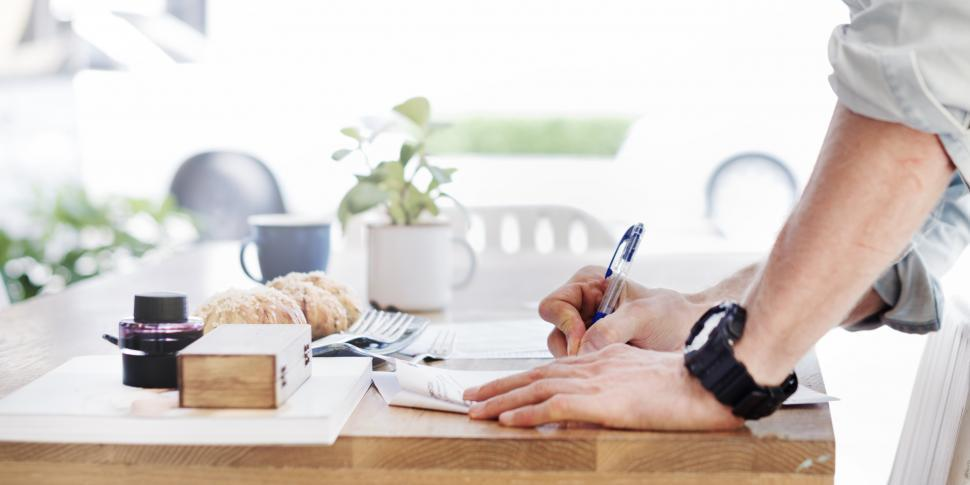 Download Free Stock Photo of A person writing on the paper
