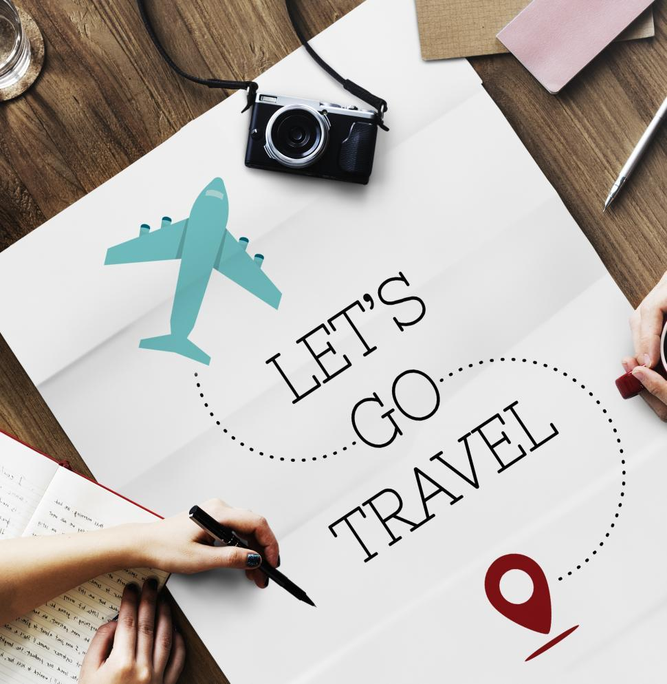 Download Free Stock Photo of Flat lay of a travel poster with the caption-  LET S GO TRAVEL
