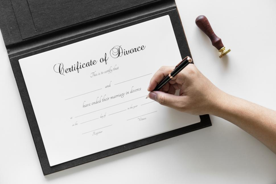 Download Free Stock Photo of A hand writing on the Certificate of Divorce