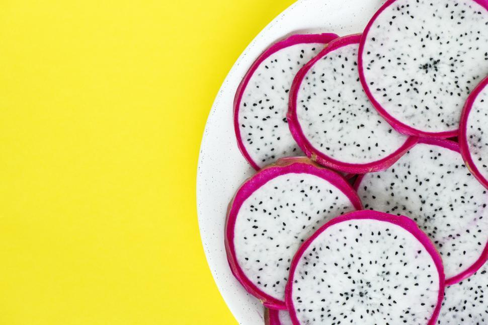 Download Free Stock Photo of Flat lay of dragon fruit slices