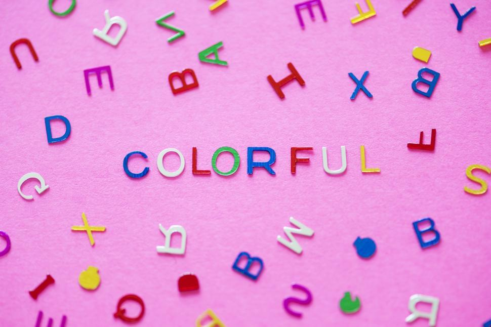 Download Free Stock Photo of Flat lay of the word COLORFUL arranged with plastic alphabet blocks