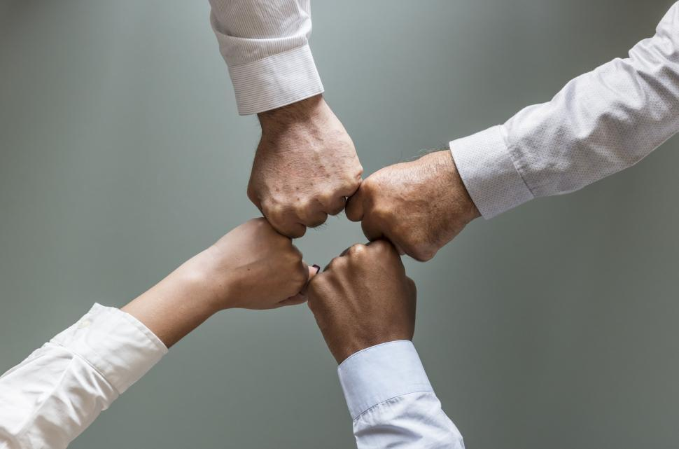 Download Free Stock HD Photo of Flay lay of hands giving Fist Bump in agreement Online